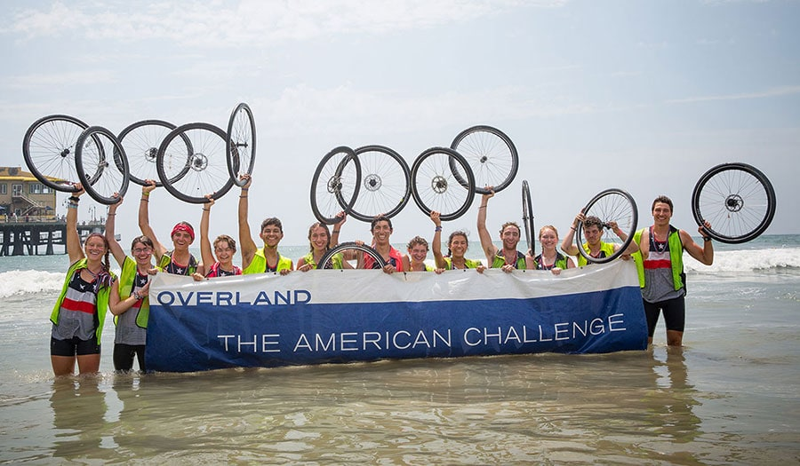 Teens pose after biking across the country on a teen summer biking trip
