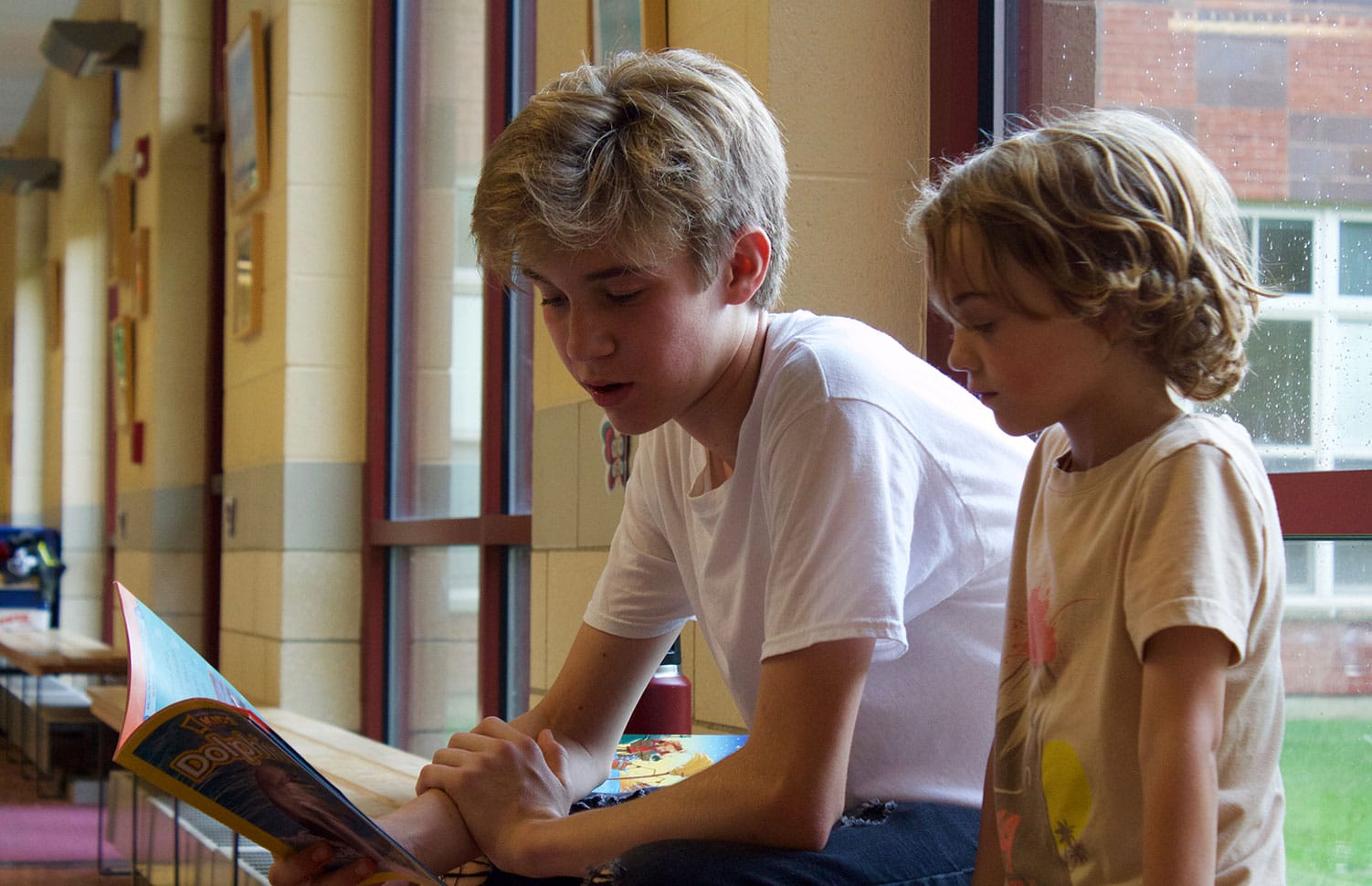 boy serving reading to child