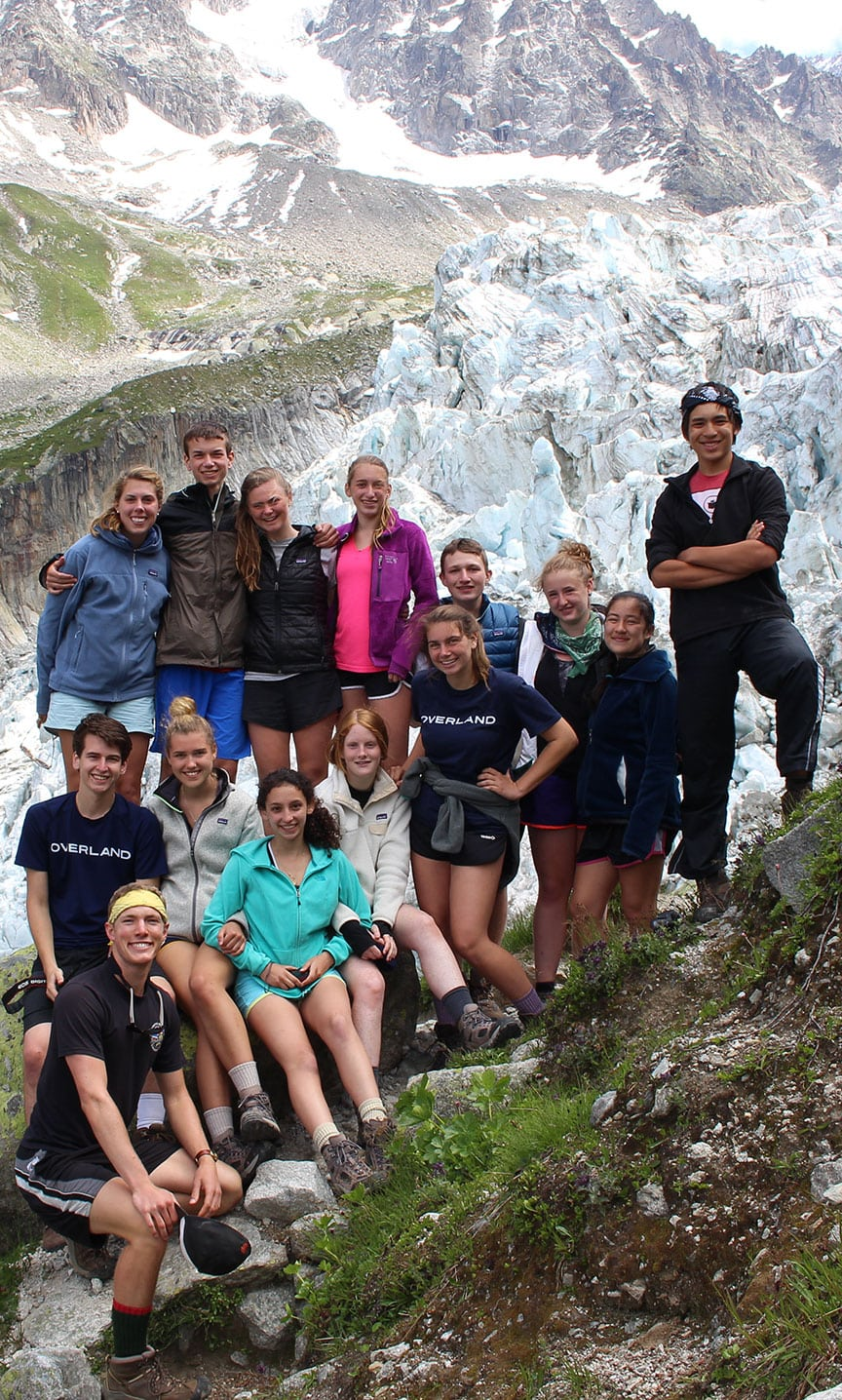 Group photo from this summer of campers take a quick respite from hiking