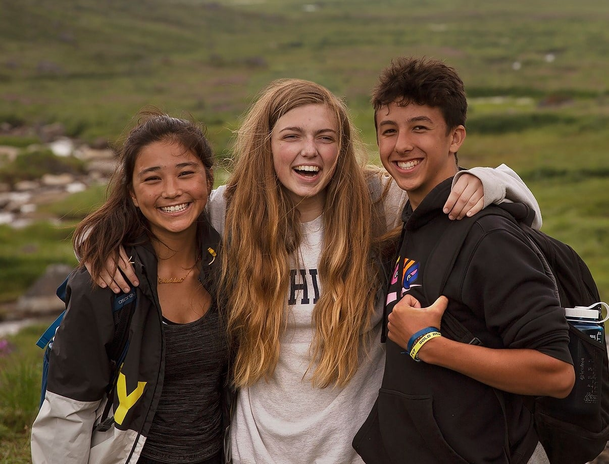 Group of teen campers smiling for a summer photo opportunity while on an Adventure trip to Alaska with Overland