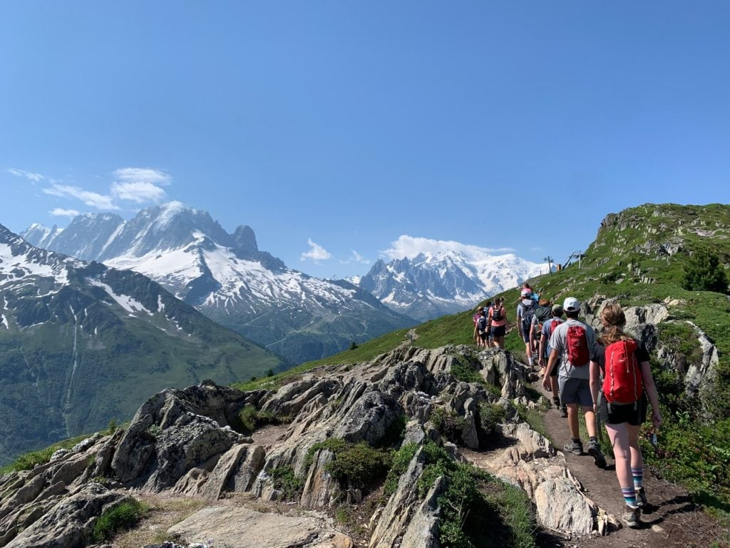 Group hikes in the French Alps during their summer hiking and language trip